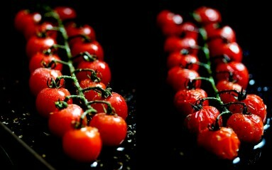 Food photography Example - close up of tomatoes on a vine on a dark background