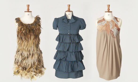 Three vintage dresses on traditional mannequins